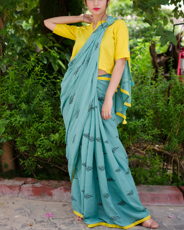 Turquoise sari with crop top blouse.  1