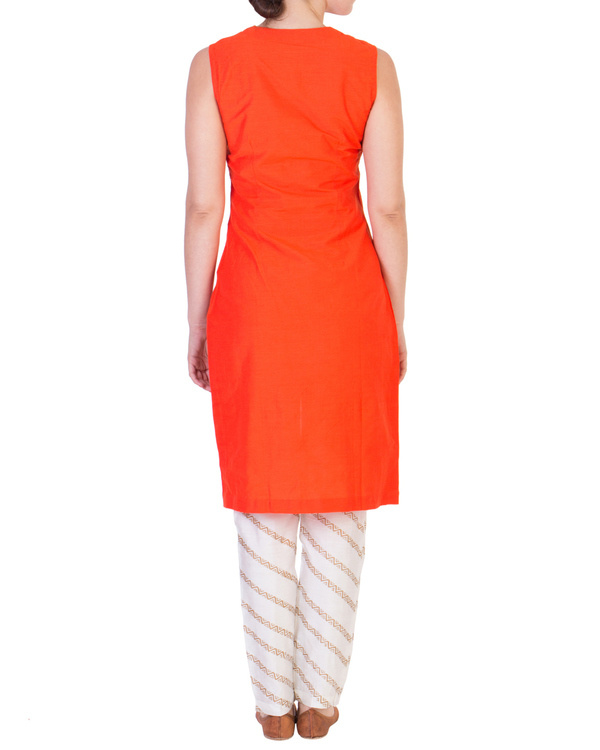 Orange solid straight tunic with tapered printed pants in off white 2