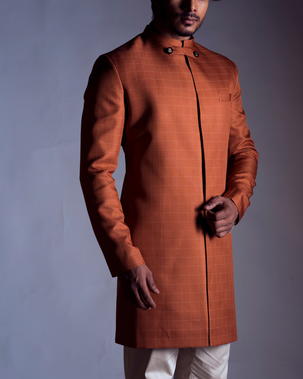 Rust orange achkan with cream trousers 1