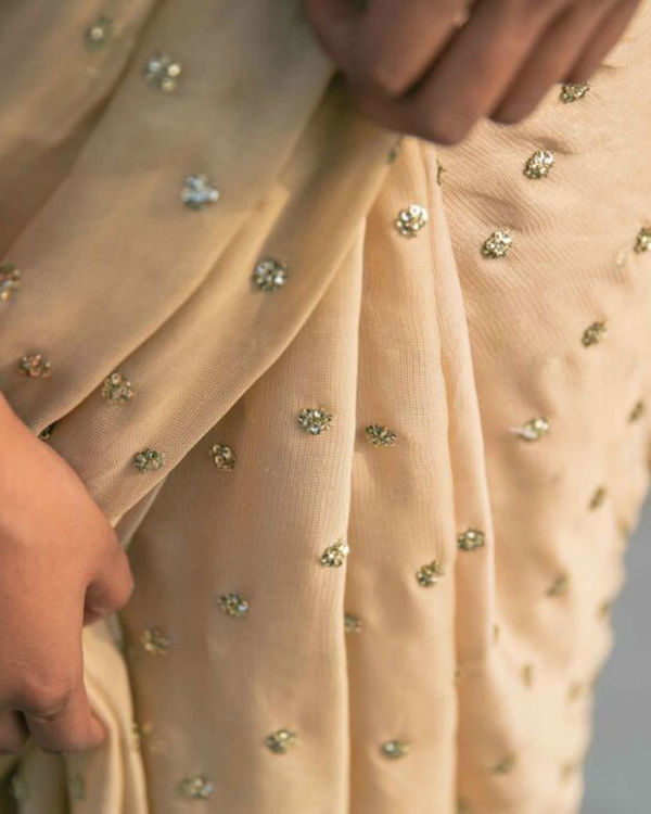 Beige saree with golden sequins 2