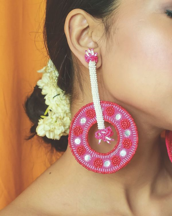 Fuchsia pink beaded circular dangler earrings 1