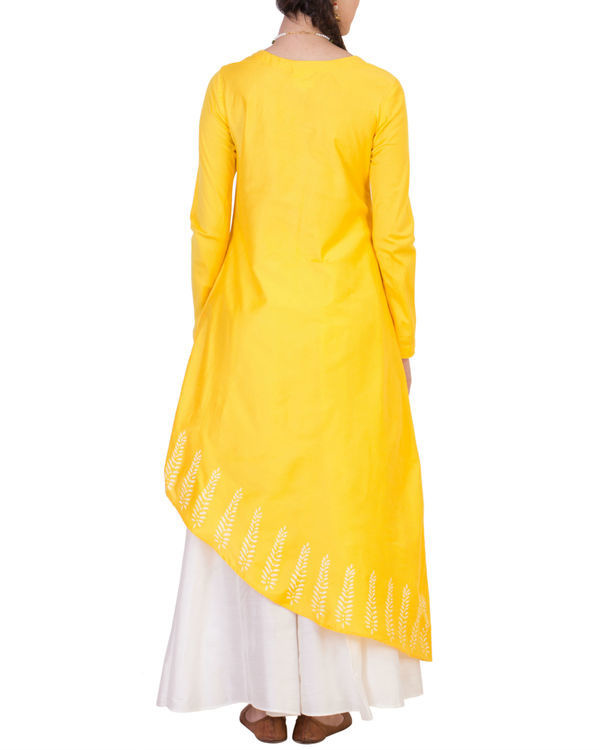 Yellow tunic with white skirt 2