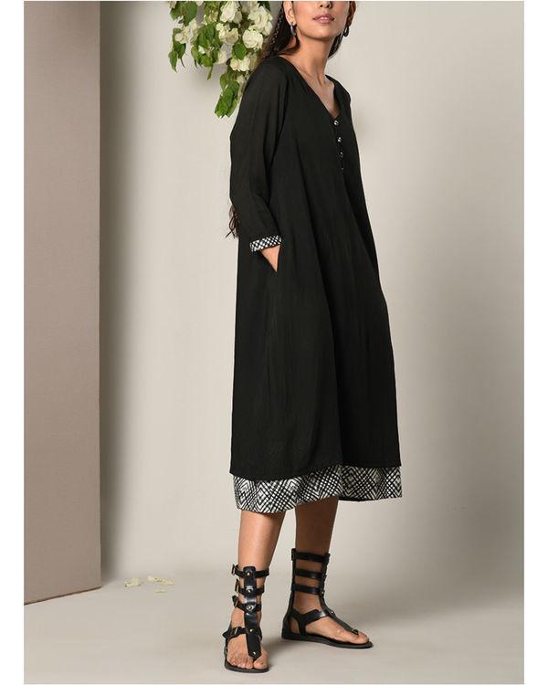 Black peek-a-boo button dress 1