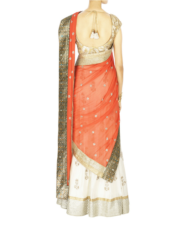 Offwhite lehanga with orange dupatta and golden blouse 1