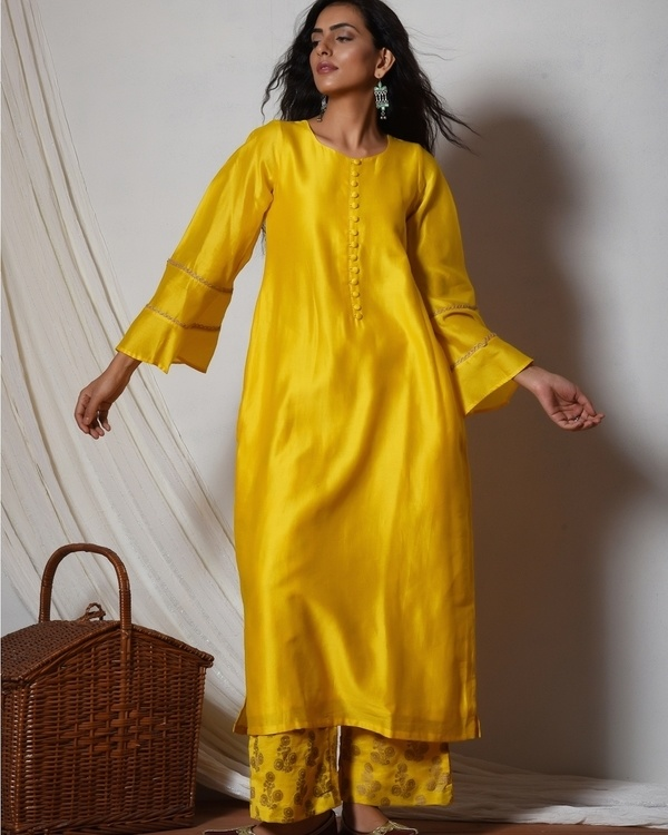 Yellow bell sleeve kurta with gold booti farshi pant 1