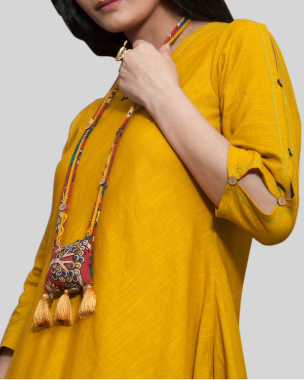Mustard cowl dress with locket necklace 2
