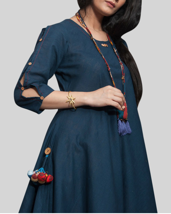 Navy blue cowl dress with locket necklace 1