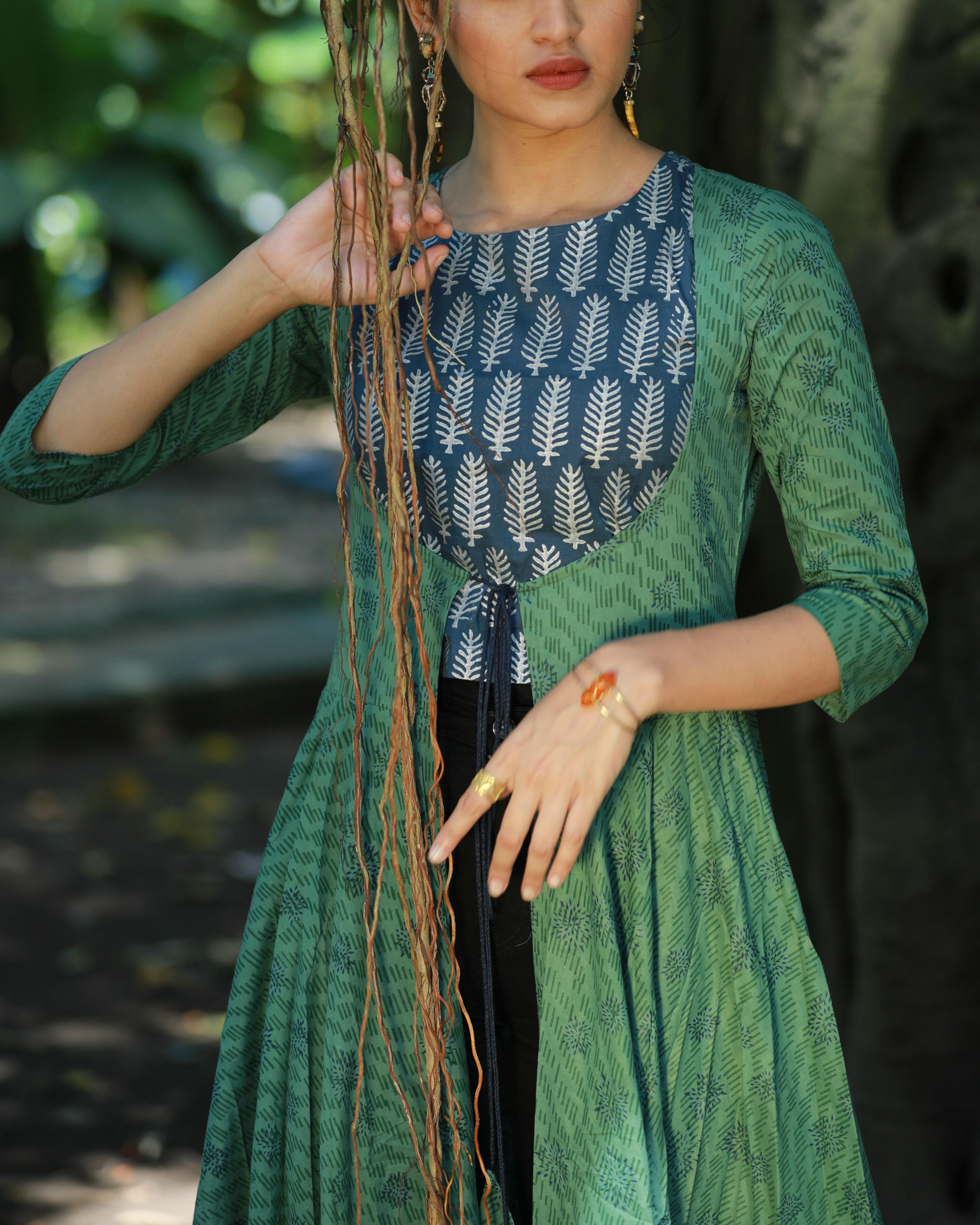 f401afcb89d93 Blue crop top and green flared cape set by Label Harsha Khatry