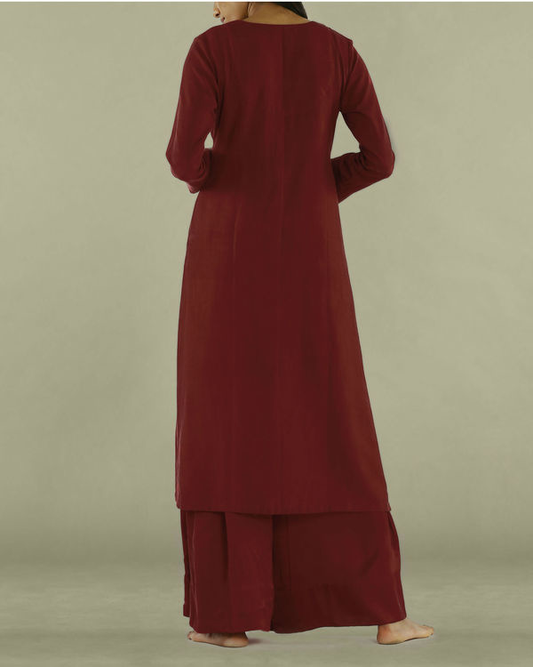 Red tunic with textured yoke 1