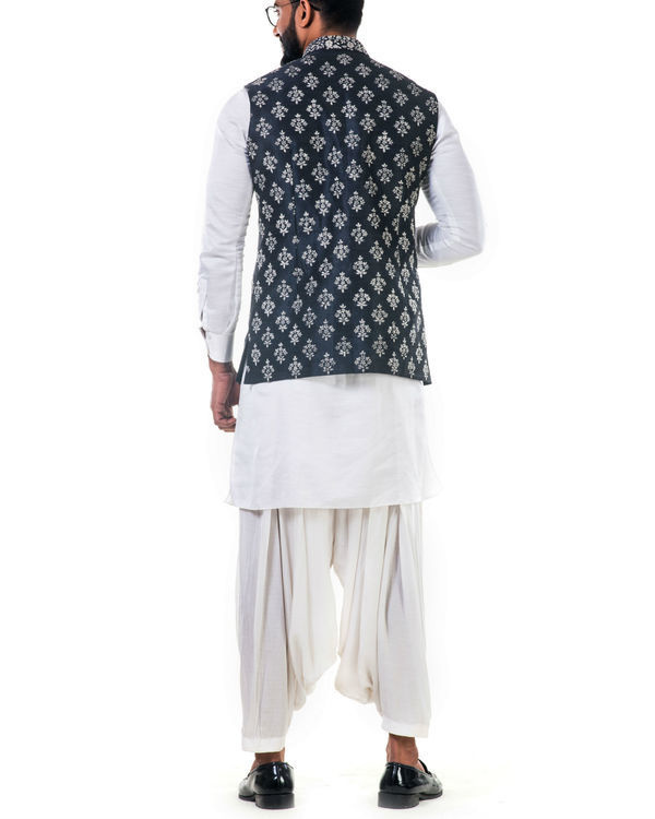 White linen satin kurta set with a black silk nehru jacket with white cord floral embroidery 3